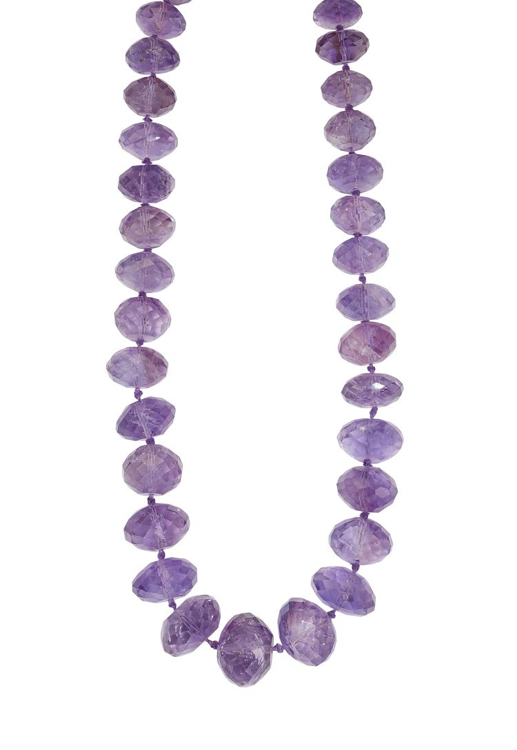 An amethyst necklace, composed of a single-row of faceted graduated beads, 57cm long