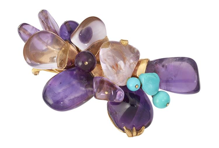 An impressive French amethyst and turquoise clip brooch, designed as an abstract spray of tumbled amethysts with turquoise three stone accents, French assay marks and maker's mark E A, 7.0cm long