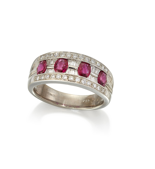 A ruby and diamond half-hoop ring, composed of four cushion-shaped rubies with baguette diamond six stone divisions within diamond line border to tapering hoop, ring size U