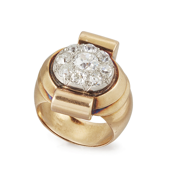 A French 1940s gold, platinum and diamond ring, of bombe cluster design, the central platinum oval bezel with pave old-brilliant-cut diamond cluster within ribbed border and domed cylindrical shoulders, circa 1945, French assay marks, ring size M