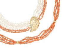 Two coral necklaces, the first composed of five rows of uniform coral, corallium rubrum, uniform beads with fluted spherical bead spacers, 84cm long; the second composed of two rows of uniform coral corallium rubrum, beads entwined with six rows of non-nucleated cultured pearls, to a stylised shell design clasp, 62cm long (2)