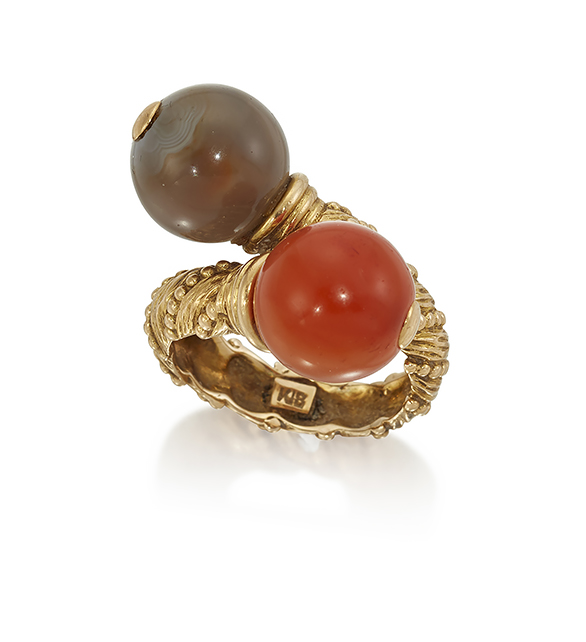 An agate ring, designed as a grey and cornelian agate bead two stone crossover ring to an abstract twist design hoop with bead work striated decoration, circa 1970, ring size L