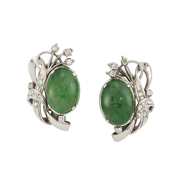 A pair of jadeite jade and diamond earclips, each designed as a single oval cabochon apple green jade in four claw mount with single-cut diamond stylised floral spray detail, 2.5cm long (Please note the jade has not been tested for natural colour origin)