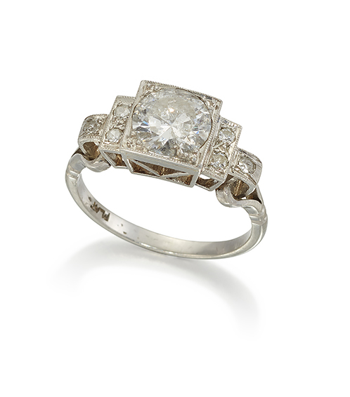 A diamond single stone ring, the circular-cut diamond weighing approximately 1.60 carats, in square millegrain setting, to single-cut diamond three stone stepped shoulders, to a platinum hoop, ring size Q