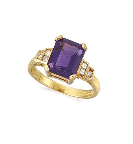 An 18ct. gold, amethyst and diamond ring, the single rectangular-cut cornered amethyst in claw-set mount with circular-cut diamond stepped four stone shoulders, London hallmarks, 2004, ring size N