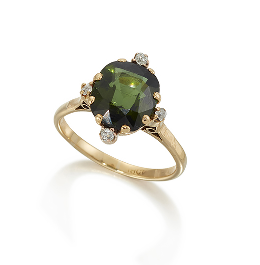 A green tourmaline ring, the claw mounted oval cut tourmaline with four diamonds to the compass points, ring size Q/R