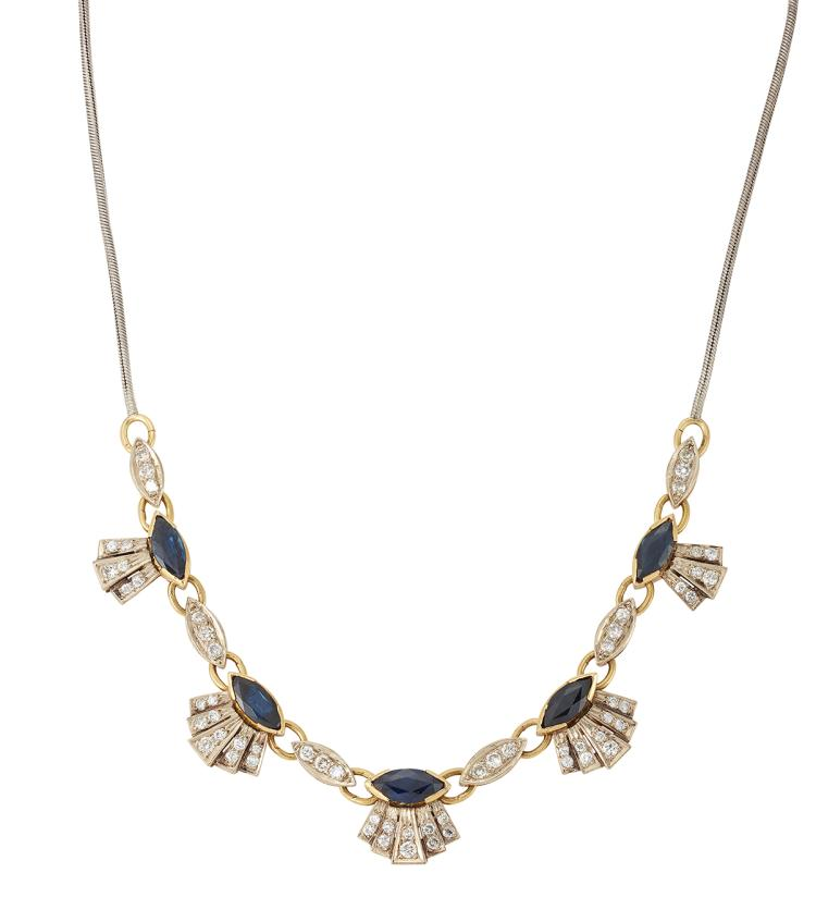 A diamond and sapphire necklace, designed as five circular-cut diamond and navette-cut sapphire palmette cluster graduated panels with circular-cut diamond three stone connecting links to a fox tail link neckchain, 40cm long
