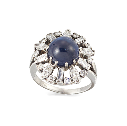 A platinum, sapphire and diamond cluster ring, the circular cluster with single claw-set cabochon sapphire and baguette and circular-cut diamond openwork border, French import marks, ring size J
