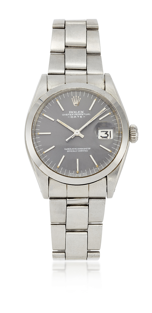 A stainless steel 'Oyster date' automatic wristwatch, by Rolex Ref. 1500, the slate coloured silvered dial with applied luminous baton markers, luminous hands, magnified date aperture and sweep seconds, signed Rolex Oyster Perpetual Date, acrylic crystal, the tonneau-shaped case with screw down crown and screw on case back, serial number 3196949, to Rolex bracelet with deployant clasp, circa 1975, case 35mm dia, with presentation case and documents