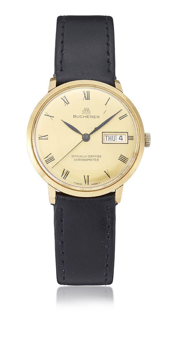 An automatic calendar wristwatch, by Bucherer, the champagne dial with black Roman Numerals and hands, sweep centre seconds and aperture at 3 o'clock for day and date, signed Bucherer, turned down lugs and snap on back, circa 1960, case 34mm