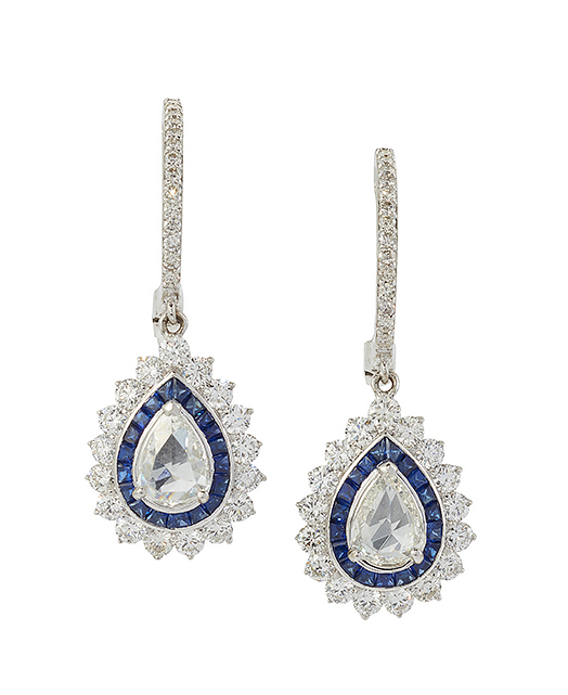 A pair of rose-cut diamond sapphire ear pendants, each with central collet-set rose-cut diamond drop with circular-cut diamond and calibre sapphire border to diamond line suspensions, 3.5cm long