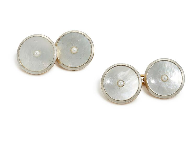 A pair of early 20th century 18ct. gold and mother-of-pearl cufflinks, each designed as a circular mother-of-pearl panel with central seed pearl, to chain-link connections, circa 1930, in fitted case stamped Goldsmiths & Silversmiths Company Ltd.