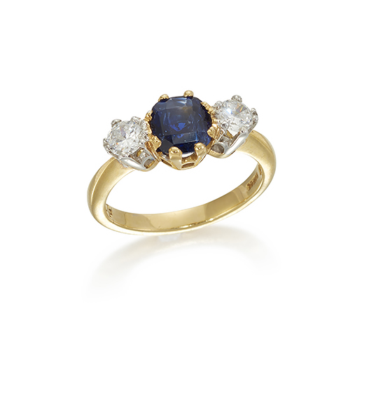 A sapphire and diamond three stone ring, the central square-cut sapphire with circular-cut diamond shoulders, approximate total weight of diamonds, 0.50 carats, ring size M