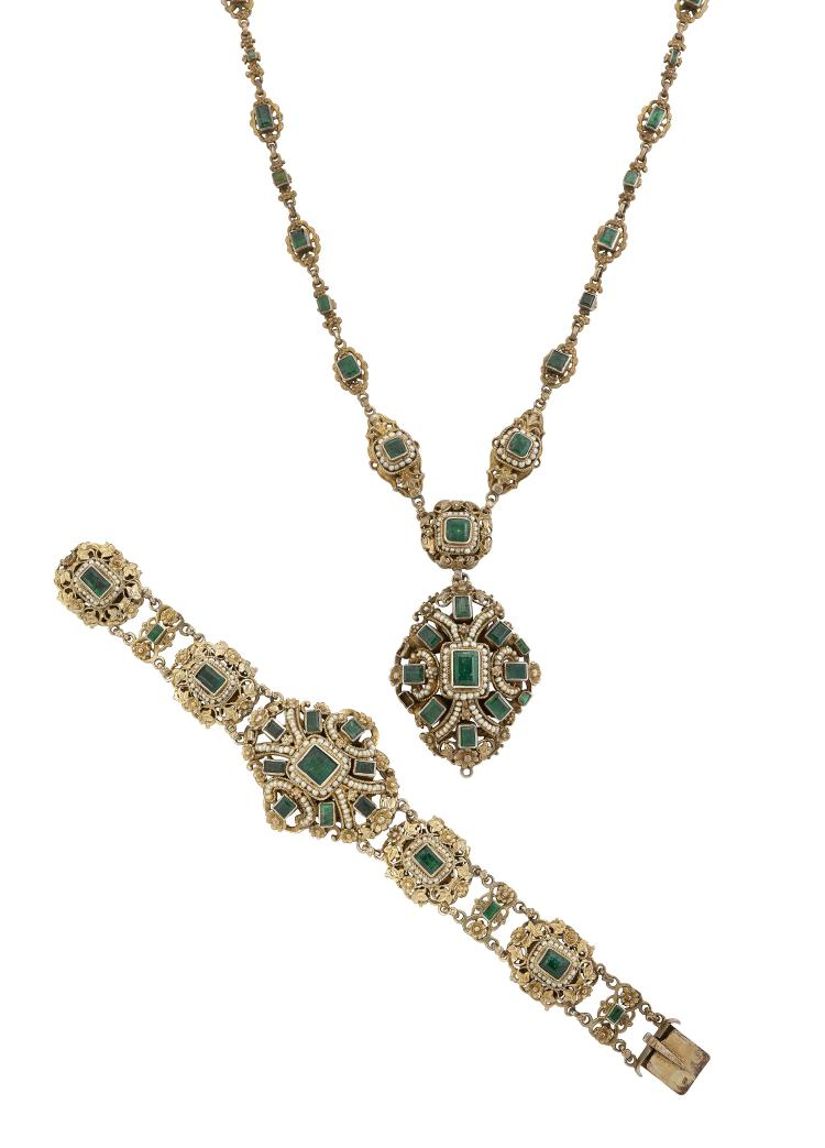 A 19th century Austro-Hungarian emerald & silver-gilt parure, of Neo-Renaissance style comprising a necklace designed as a series of closed-set rectangular-cut emerald collet links with foliate and seed pearl borders to a larger central panel suspending a matching oval cluster pendant additional drop deficient, 41cm long, with bracelet, brooch and ear pendants en suite, later fitted case stamped Harvey & Gore