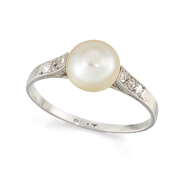 A platinum, pearl and diamond ring, the single bouton pearl with old-brilliant-cut diamond three stone shoulders, in platinum hoop, circa 1930, ring size Q (please note that the pearl has not been tested for natural origin)
