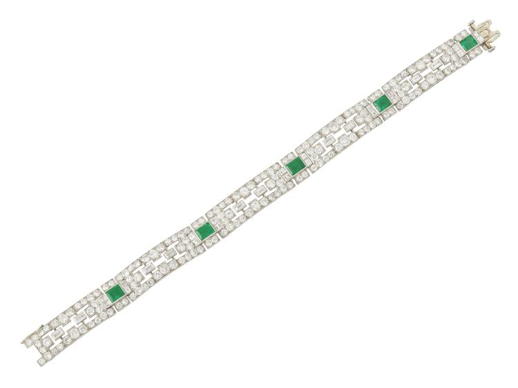 An Art Deco, French, platinum diamond and emerald flexible bracelet, composed of baguette and circular-cut diamond geometric articulated panels with five collet-set rectangular-cut emerald spacers, circa 1930, French assay and makers mark, indistinct, 18cm long