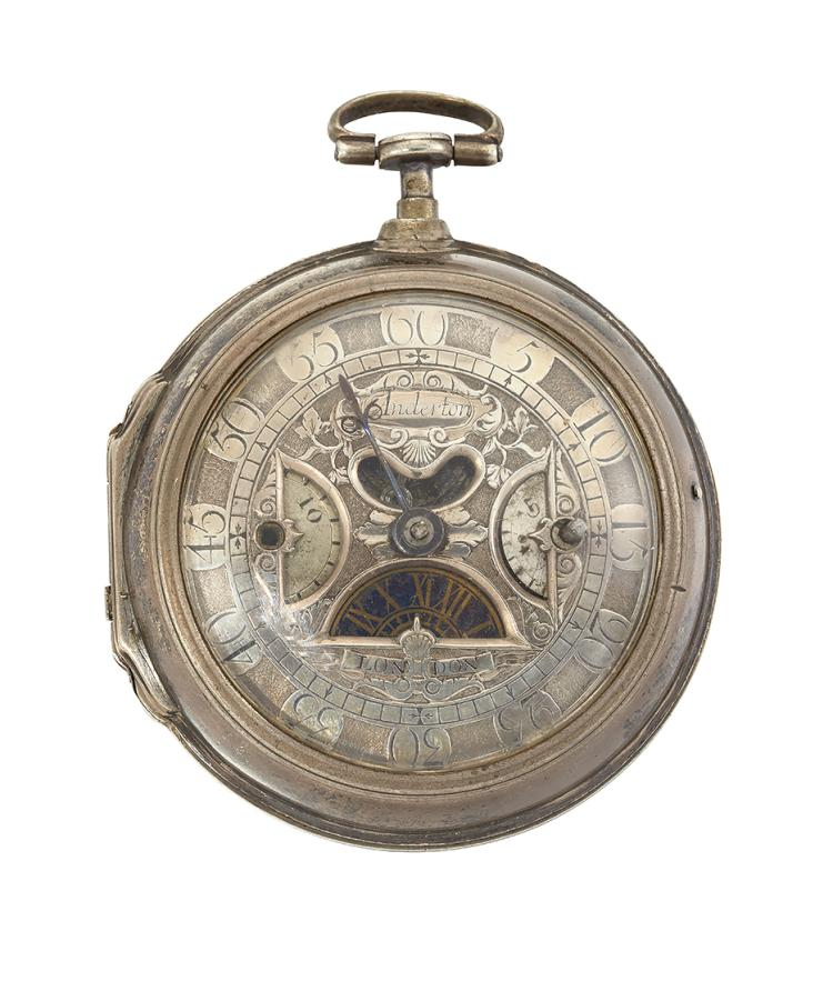 An early 18th century silver openface, verge pocket watch, by Robert Anderton, the silver dial with half-moon hour aperture with Roman numerals on blued chapter, mock pendulum and half-moon apertures for fast and slow adjustment, and single beetle minute hand, signed Anderton the verge escapement with fusee and columnar pillars, with full plate signed Robert Anderton, London, number 100, in later consular plain silver case, London hallmarks, 1783, case 56mm