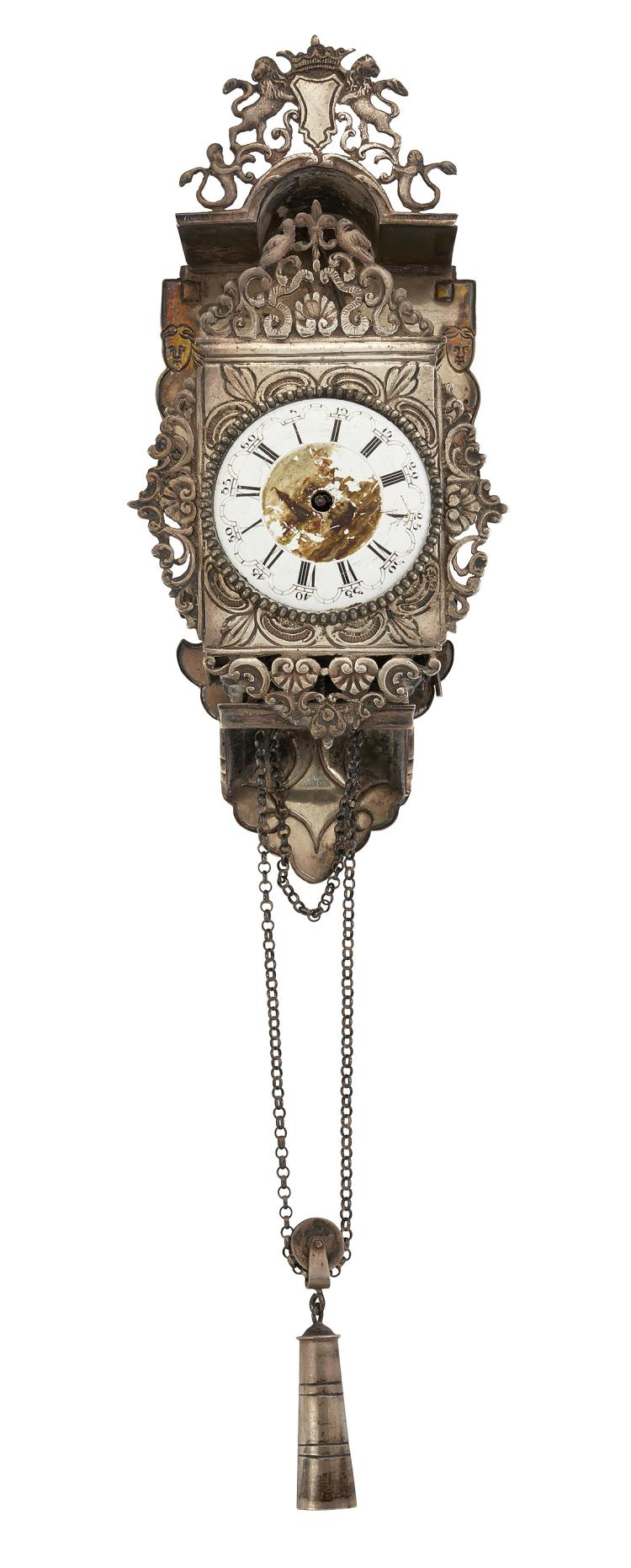 An unusual silver miniature wall clock, the 18th century Dutch verge timepiece with white enamel dial, Roman numerals and central enamelled scene, within cabled border, the verge escapement with fusee pierced balance cock and three arm wheel, signed Jn. Danby, London, in later ornate silver clock mount with foliate pierced ribbon decoration and faux pendulum and chain, 12.5cm