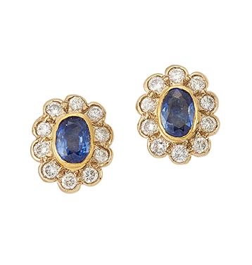 A pair of 18ct. gold, sapphire and diamond studs, each designed as a collet-set oval sapphire with circular-cut diamond border, post fittings