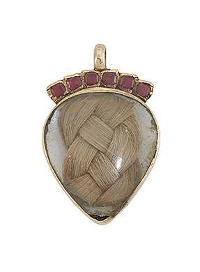 An early 19th century heart pendant, the heart-shaped rock crystal locket enclosing plaited hear, to a closed-set ruby six stone surmount, circa 1800, 22mm