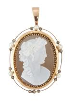 A 19th century agate cameo brooch/pendant, the oval cameo carved to depict the female profile of Bacchante facing right, within gold, rose-cut diamond and seed pearl openwork border, to pendant loop,  circa 1860, cameo probably French, brooch pin deficient, 5.5cm long