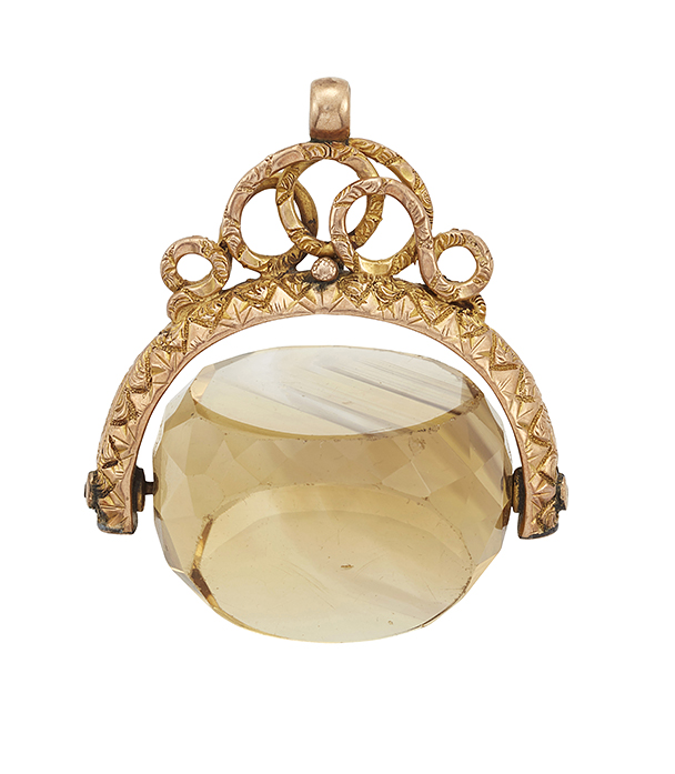 A 19th century gold and citrine swivel fob seal, the faceted citrine with triple sided vacant matrices, to a chased and engraved mount with scrolling surmount, circa 1840