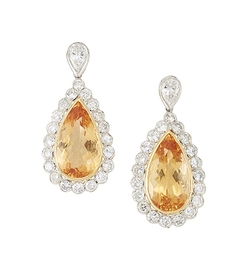 A pair of diamond and topaz ear pendants, each with pear-shaped yellow topaz weighing approximately 3.20 carats, with circular-cut diamond surround, to a pair-shaped diamond single stone stud suspension, 2.5cm long
