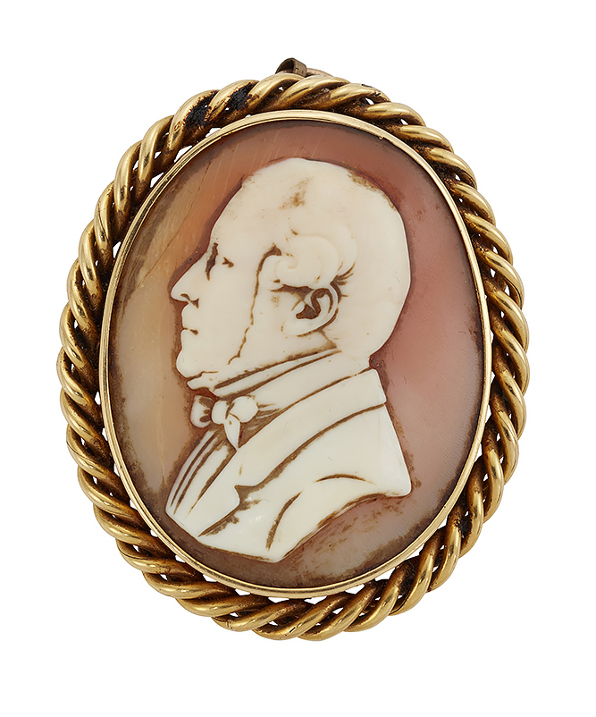 A 19th century gold mounted cameo brooch, the oval shell cameo carved to depict the profile of a gentleman, within gold ropework border, pin deficient, circa 1880, to a base metal chain