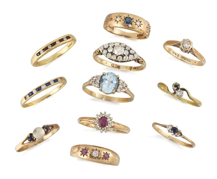 A group of eleven rings, comprising: a Victorian gold and old brilliant-cut diamond marquise cluster ring (hoop cut); a 9ct, gold oval aquamarine single stone ring with diamond six stone triangular cluster shoulders; two 18ct gold diamond and ruby half-eternity rings; a ruby and circular-cut diamond cluster ring; a 9ct gold sapphire and diamond three stone gypsy ring; a diamond and ruby three stone gypsy ring; a 9ct. gold diamond single stone ring; A diamond two stone crossover ring, one stone deficient; a sapphire and diamond three stone ring, one stone deficient; and a sapphire and paste three stone ring (11)