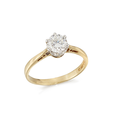 An 18ct. gold, diamond single stone ring, the circular-cut diamond weighing approximately 0.59 carats, in claw-set mount, London hallmarks, 1992, ring size L