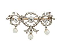 An Edwardian gold, platinum, diamond and pearl brooch, of entwined garland design set with three millegrain-set old-brilliant-cut diamonds with diamond and rose-cut diamond detail, suspending three untested pearl drops, 3.5cm wide