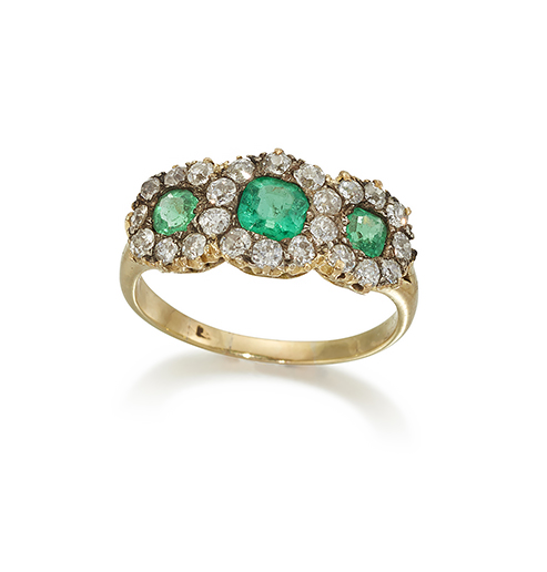 An Edwardian, diamond and emerald ring, designed as a cushion-cut emerald and old-brilliant-cut diamond triple cluster to tapering claw shoulders and plain hoop, circa 1905, ring size M
