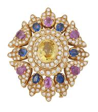 A large, diamond and sapphire clip brooch, with central collet-set oval yellow sapphire within circular-cut diamond double-row border and sapphire, pink sapphire and diamond stylised leaf cluster surround,  6cm long, with case stamped Moussaieff