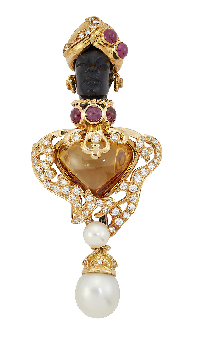 A diamond, ruby and citrine blackamoor brooch, the circular-cut diamond tunic set in the centre with a hear-shaped citrine, the carved head with cabochon ruby and diamond turban and similar ruby collar, diamond ear pendants, suspending a cultured pearl drop and surmount, 8.5cm long