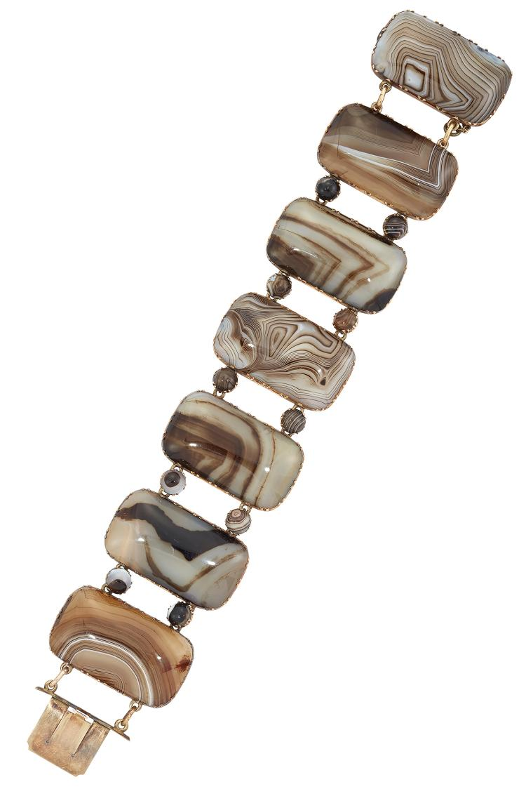 A Georgian gold-mounted agate bracelet, composed of seven rectangular polished agate panels in gold cut-down settings, with circular cabochon agate spacers, circa 1800, 18.5cm long