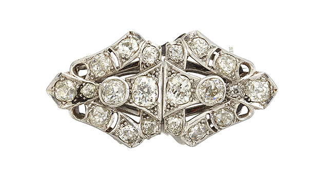 An Art Deco diamond double clip brooch, each of triangular openwork cluster design, set with old-mine cut diamonds, to detachable frame, circa 1930, 3.7cm wide