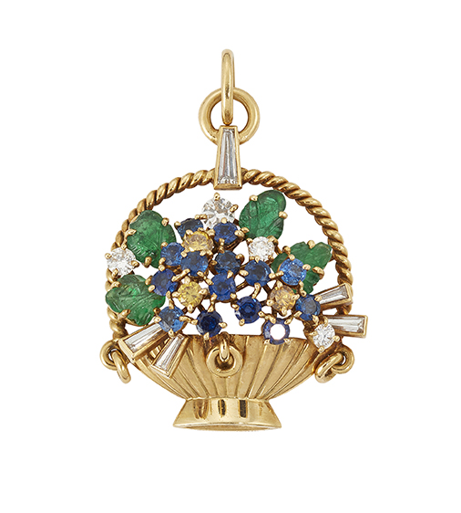 An 18ct. gold, diamond and gem basket of flowers pendant, by Cartier, the fluted basket with spray of claw-set yellow diamond and sapphire flowerheads, carved emerald leaves and circular and baguette diamond detail, signed JC and Cartier, London, London hallmarks, 1976, 3.5cm long (please note that the yellow diamonds have not been tested for natural colour origin)