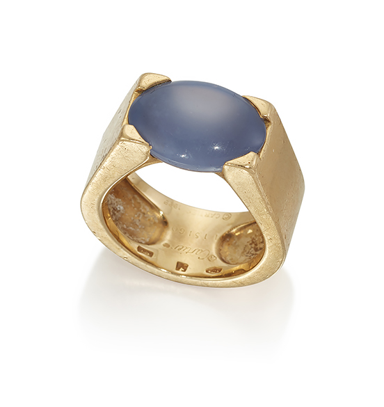 An 18ct. gold, blue chalcedony 'Tankissme' ring, by Cartier, the oval cabochon chalcedony mounted in wide hoop, signed Cartier, 1999, number 15160, French mark, European Convention hallmarks, ring size M