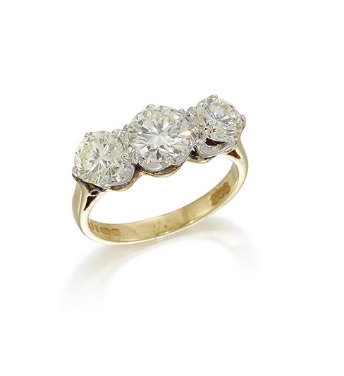 An 18ct. gold, diamond three stone ring, the three circular-cut diamonds in claw-set mount, approximate total weight of diamonds, 2.0 carats, to a plain hoop, ring size K
