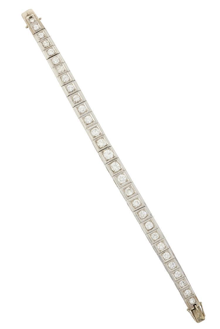 A diamond flexible bracelet, composed of a graduated line of circular-cut diamonds in box panels, 18.9cm long