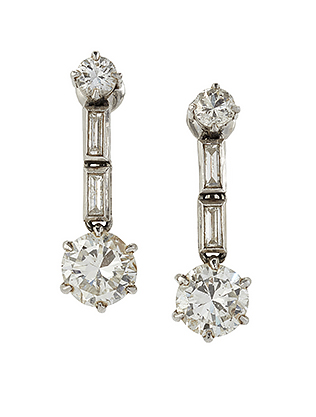 A pair of diamond drop earrings, each designed as a single circular-cut diamond drop, diamond weighing approximately 0.70 carats, in claw-set mount to baguette diamond two stone articulated links and diamond single stone suspension, screw-back fittings, in case