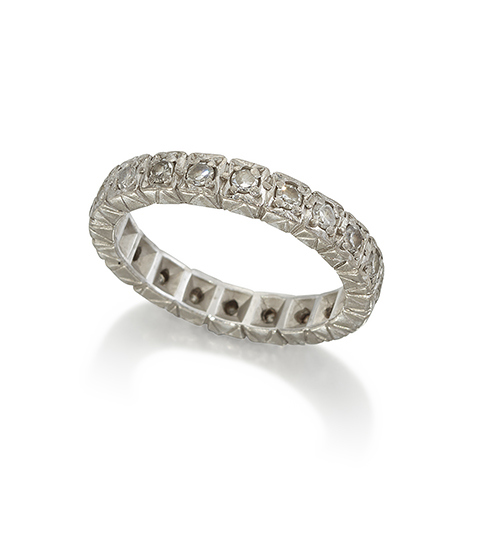 A diamond eternity ring, set with a row of single-cut diamonds, in bright cut hoop, ring size N,