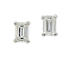 A pair of rectangular-cut diamond ear studs, each in claw-set mounts, approximate total weight of diamonds 1.00 carats