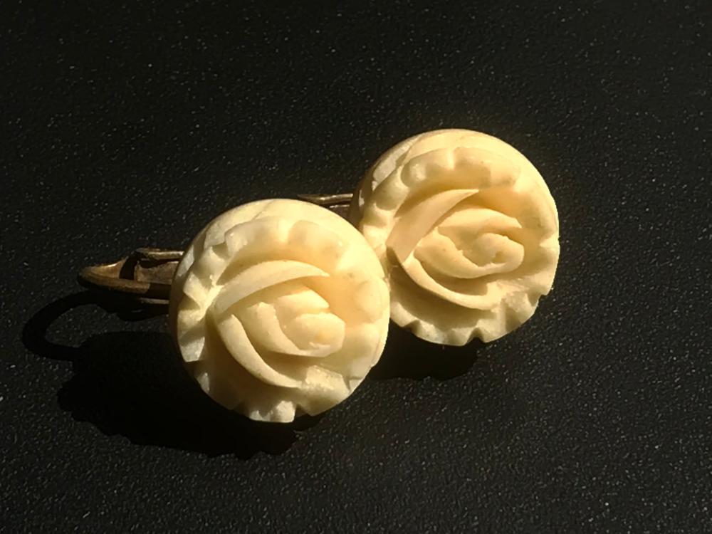Pair of Carved Flower Earrings
