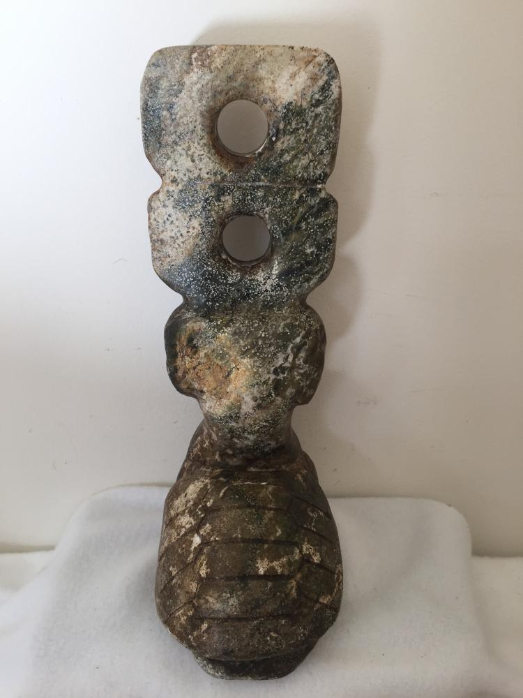 Neolithic style stone sculpture