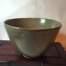 Antique half brown glazed ceremic bowl