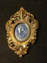 Small Metal Mounted Mirror