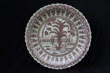 A LARGE COPPER RED GLAZED PLATE