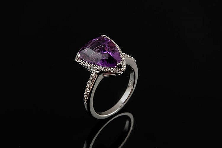 A GOLD, AMETHYST AND DIAMOND RING, BY CHRISTOS M