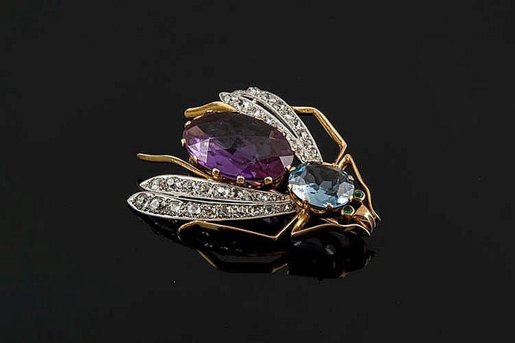 A GOLD, ENAMEL, BLUE AND PURPLE GEMSTONE AND DIAMOND BROOCH